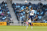 SAINT PAUL, MN - MAY 12: Emanuel Reynoso #10 of Minnesota United FC and Janio Bikel #19 of Vancouver Whitecaps FC battle for the ball during a game between Vancouver Whitecaps and Minnesota United FC at Allianz Field on May 12, 2021 in Saint Paul, Minnesota.