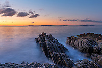 """Colorful sunrise on the Mediterranean Sea, the rocks of pointe Layet and """"Port Cros"""" national park island, gulf of Saint-Tropez, Azure coast France"""