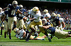 Sept. 1, 2012; Notre Dame running back Theo Riddick rushes to the end  zone for a touchdown as Navy Midshipmen linebacker Keegan Wetzel (48) attempts to tackle during the first quarter the 2012 Emerald Isle Classic at Aviva Stadium in Dublin, Ireland. Photo by Barbara Johnston/University of Notre Dame