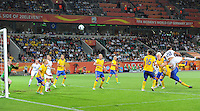 Abby Wambach (r) of team USA scores 1:2 against goalkeeper Hedvig Lindahl of team Sweden during the FIFA Women's World Cup at the FIFA Stadium in Wolfsburg, Germany on July 6thd, 2011.