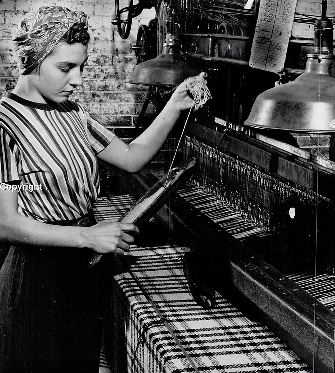 METIER Fileuse en 1947<br /> <br /> Thousands; of women are employed in this industry; principally located in Ontario and Quebec. Thousands more of feminine customers wear Canadian cloth. 1947<br /> <br /> PHOTO : Toronto Star Archives - AQP