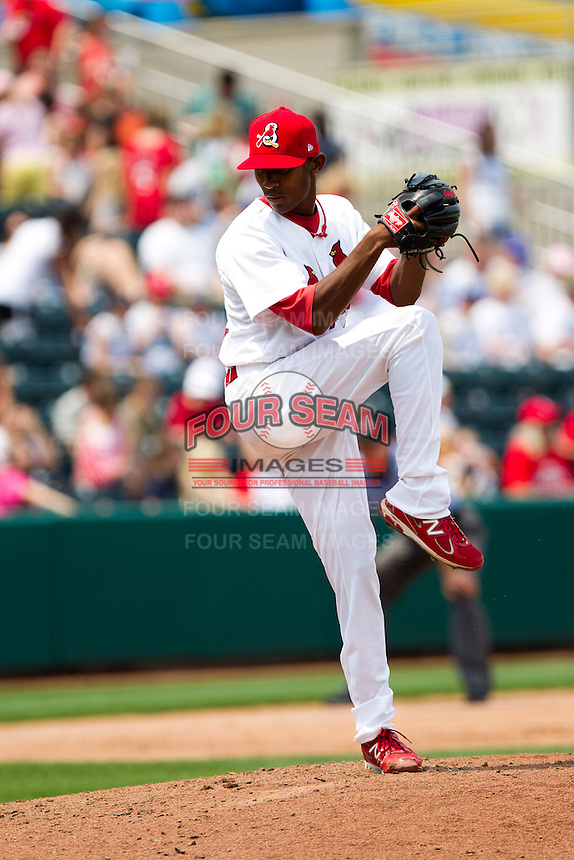 Samuel Freeman (12) of the Springfield Cardinals winds up during a game against the Arkansas Travelers on May 10, 2011 at Hammons Field in Springfield, Missouri.  Photo By David Welker/Four Seam Images.