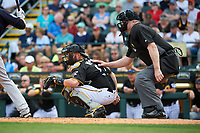 Umpire Bill Welke and Pittsburgh Pirates catcher Jackson Williams (87) during a Grapefruit League Spring Training game against the New York Yankees on March 6, 2017 at LECOM Park in Bradenton, Florida.  Pittsburgh defeated New York 13-1.  (Mike Janes/Four Seam Images)