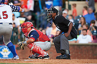 Hagerstown Suns catcher Jorge Tillero (11) and umpire Edwin Moscoso during a game against the Lexington Legends on May 22, 2015 at Whitaker Bank Ballpark in Lexington, Kentucky.  Lexington defeated Hagerstown 5-1.  (Mike Janes/Four Seam Images)