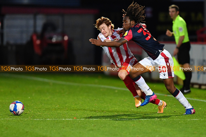 Arthur Read of Stevenage FC and Peter Kioso of Bolton Wanderers F.C. during Stevenage vs Bolton Wanderers, Sky Bet EFL League 2 Football at the Lamex Stadium on 21st November 2020