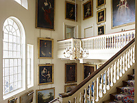 The 17th and 18th century portraits and landscapes that line the staircase to the private apartments are lit by a tall Venetian window