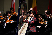 Valerio Lisci of Italy performs with the Indiana University Summer Philharmonic Orchestra during the Stage IV concert at the 11th USA International Harp Competition at Indiana University in Bloomington, Indiana on Saturday, July 13, 2019. (Photo by James Brosher)