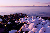 Stanley Park, Vancouver, BC, British Columbia, Canada, Winter - Snow Covered Rocks on Beach at English Bay, Sunset