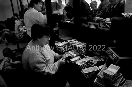 Tirana, Albania<br /> February 1997<br /> <br /> People crowd into the Albanian Savings Bank to receive up 60% refunds on their original investments after the pyramid scheme they invested in failed. The process is very slow and frustrating.