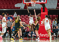 COLLEGE PARK, MD - FEBRUARY 13: Diamond Miller #14 of Maryland shoots over McKenna Warnock #14 of Iowa during a game between Iowa and Maryland at Xfinity Center on February 13, 2020 in College Park, Maryland.