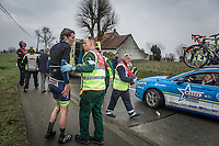 Yoann Offredo (FRA/Wanty Group Gobert) after a peloton crash.  Team manager Hilaire Verschueren observing the situation from his teamcar... <br /> <br /> <br /> 102nd Ronde van Vlaanderen 2018 (1.UWT)<br /> Antwerpen - Oudenaarde (BEL): 265km