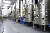 Mas La Chevaliere. near Beziers. Languedoc. Stainless steel fermentation and storage tanks. Cooling coils for temperature control. France. Europe.