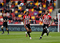22nd May 2021; Brentford Community Stadium, London, England; English Football League Championship Football, Playoff, Brentford FC versus Bournemouth; Ethan Pinnock of Brentford heads the ball out with Pontus Jansson of Brentford supporting