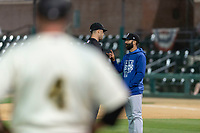 Rancho Cucamonga Quakes manager Mark Kertenian argues a call with field umpire Ty Kraus as Rawhide manager Shawn Roof observes from a distance during a California League game against the Visalia Rawhide on April 9, 2019 in Visalia, California. Visalia defeated Rancho Cucamonga 8-5. (Zachary Lucy/Four Seam Images)
