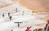 News media coverage of competitors as they prepare to paddle out at the 2016 Big Wave Eddie Aikau Contest, Waimea Bay, North Shore, Oahu