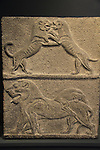 Israel, Jerusalem, lion and lioness at play, a basalt relief from Beth Shean, 14th century BC, at the Israel Museum