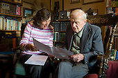 Age UK Norfolk Money Matters volunteer adviser with an eldertly client in his isolated cottage in Great Plumstead; Norwich.