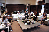 Pope Benedict (4th L) chats with Jordan's King Abdullah (3rd R) and his family at the Royal Palace in Amman May 8, 2009..