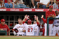 Mike Trout #27 of the Los Angeles Angels is greeted by teammate Chris Iannetta #17 after scoring during a game against the Cleveland Indians at Angel Stadium on August 14, 2012 in Anaheim, California. Los Angeles defeated Cleveland 9-6. (Larry Goren/Four Seam Images)