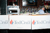 Campaign signs hang off the buffet table before Texas senator and Republican presidential candidate Ted Cruz speaks to a crowd at a business round-table at the Draft Sports Bar and Grille in Concord, New Hampshire.