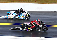 Mar 16, 2014; Gainesville, FL, USA; NHRA pro stock motorcycle rider Matt Smith (near lane) races alongside Jerry Savoie during the Gatornationals at Gainesville Raceway Mandatory Credit: Mark J. Rebilas-USA TODAY Sports