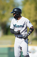 Salt River Rafters center fielder Monte Harrison (4), of the Miami Marlins organization, celebrates by rowing an imaginary oar during the Arizona Fall League Championship Game against the Peoria Javelinas at Scottsdale Stadium on November 17, 2018 in Scottsdale, Arizona. Peoria defeated Salt River 3-2 in 10 innings. (Zachary Lucy/Four Seam Images)