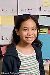 Elementary school Grade 5 closeup portrait of girl vertical