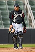 Catcher Miguel Gonzalez #12 of the Kannapolis Intimidators at Fieldcrest Cannon Stadium April 3, 2010, in Kannapolis, North Carolina.  Photo by Brian Westerholt / Four Seam Images