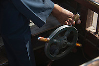 Helmsman of a water taxi in Dubai.
