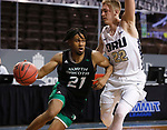 SIOUX FALLS, SD - MARCH 7: Ethan Igbanugo #21 of the North Dakota Fighting Hawks drives past Francis Lacis #22 of the Oral Roberts Golden Eagles during the Summit League Basketball Tournament at the Sanford Pentagon in Sioux Falls, SD. (Photo by Richard Carlson/Inertia)