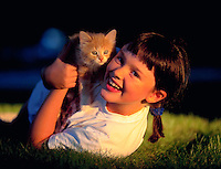 Young girl with her kitten.