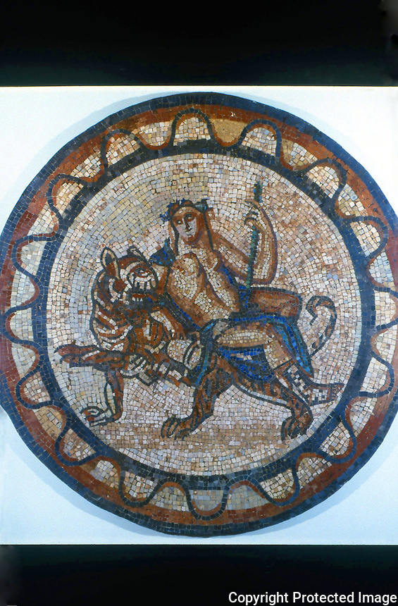Greek Art:  Bacchus riding on a tiger.  Mosaic roundel from Leadenhall Street, London.  Roman, 1st or 2nd century A.D.  Trustees of the British Museum 1986.