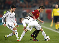 Football Soccer: UEFA Champions League AS Roma vs Qarabag FK Stadio Olimpico Rome, Italy, December 5, 2017. <br /> Roma's Diego Perotti (l) in action with Qarabag's captain Maksim Medvedev (c) and Afran Ismayilov (l) during the Uefa Champions League football soccer match between AS Roma and Qarabag FK at at Rome's Olympic stadium, December 05, 2017.<br /> UPDATE IMAGES PRESS/Isabella Bonotto
