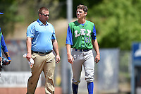 Lexington Legends starting pitcher Matt Tenuta (32) with trainer Mark Keiser after being hit by a line drive during a game against the Asheville Tourists on May 3, 2015 in Asheville, North Carolina. The Legends defeated the Tourists 6-3. (Tony Farlow/Four Seam Images)