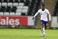 SWANSEA, WALES - NOVEMBER 12: Yunus Musah #18 of the United States  moves across the field with the ball during a game between Wales and USMNT at Liberty Stadium on November 12, 2020 in Swansea, Wales.