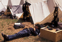 AJ3385, Civil War Reenactment, confederate, Stone Mountain, Atlanta, Georgia's Stone Mountain Park, Georgia, A man dressed as a Union Officer takes a break by his tent during the Civil War Reenactment at the Antebellum Jubilee at Stone Mountain Park in Atlanta in the state of Georgia.