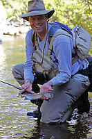 Tom Ziegler gets ready to release a Rocky Mountain National Park Rainbow Trout