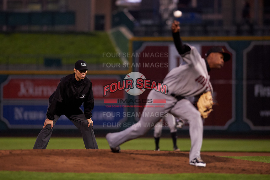 Umpire Jae-Young Kim watches Quad Cities River Bandits relief pitcher Jojanse Torres (39) during a Midwest League game between the River Bandits and Fort Wayne TinCaps at Parkview Field on May 3, 2019 in Fort Wayne, Indiana. Quad Cities defeated Fort Wayne 2-0. (Zachary Lucy/Four Seam Images)