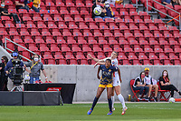 SANDY, UT - SEPTEMBER 26: Morgan Andrews #12 of OL Reign plays for the ball against Tziarra King #3 of Utah Royals FC during a game between OL Reign and Utah Royals FC at Rio Tinto Stadium on September 26, 2020 in Sandy, Utah.