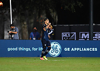 LAKE BUENA VISTA, FL - JULY 26: Alan Pulido of Sporting KC celebrates his shootout goal during a game between Vancouver Whitecaps and Sporting Kansas City at ESPN Wide World of Sports on July 26, 2020 in Lake Buena Vista, Florida.