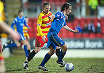 St Johnstone v Partick Thistle....09.02.11  Scottish Cup 5th Round.Stevie May is closed down by Brian Hodge.Picture by Graeme Hart..Copyright Perthshire Picture Agency.Tel: 01738 623350  Mobile: 07990 594431