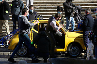 Actor Tom Cruise in a Fiat yellow 500 driven by a stuntman, during a an action scene on the set of the film Mission Impossible 7 at Spagna square, just under the Spanish steps.<br /> Rome (Italy), November 22nd 2020<br /> Photo Samantha Zucchi Insidefoto