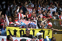 BOGOTA - COLOMBIA -19 -03-2016: Hinchas de Fortaleza FC, durante partido entre Fortaleza FC y Atletico Junior, por la fecha 11 de la Liga Aguila I-2016, jugado en el estadio Metropolitano de Techo de la ciudad de Bogota. / Fans of Fortaleza FC, during a match between Fortaleza FC and Atletico Junior, for the date 11 of the Liga Aguila I-2016 at the Metropolitano de Techo Stadium in Bogota city, Photo: VizzorImage  / Luis Ramirez / Staff.