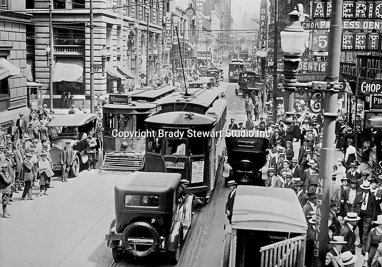 Pittsburgh PA: View of an old lantern slide created by Brady Stewart for the Pittsburgh Citizens Committee on City Plan (CCCP) when they were crafting the City Plan.  <br /> This view is of 5th Avenue at lunchtime to highlight the need for a more efficient traffic pattern.<br /> The Citizen's Committee was organized to produce the Pittsburgh Plan for infrastructure including playgrounds, major streets, Parks, Public Transit, Railroads, and Waterways. Some of the cities most accomplished and influential citizens volunteered to serve on the various committees from 1920 thru 1924. Prominent citizens included: Richard and Andrew Mellon, Charles Armstrong, Henry Buhl Jr., Edgar, Issac & Oliver Kaufmann, Roy A. Hunt, George Davison, and many many leading Pittsburgh companies. They all paid an annual subscription (dues) to fund the activities of the Citizen's Committee. Brady Stewart provided photographic services for the committee.<br /> The negative and print were ordered by the Pittsburgh Regional Planning Association for a meeting in 1968.