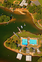 Summer campers enjoy a summer day at YMCA Camp Thunderbird, located on Lake Wylie in South Carolina. Lake Wylie is a reservoir located in York County, SC, just over the North Carolina border near Charlotte, NC. Camp Thunderbird is an overnight bording camp in Clover, SC. Since 1936, campers have enjoyed land and water activities, like sailing and skiing.