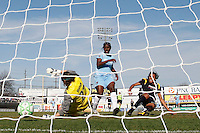 Marta Vieira da Silva (10) of the Los Angeles Sol scores past goalkeeper Jenni Branam (23) of Sky Blue FC. The Los Angeles Sol defeated Sky Blue FC 2-0 during a Women's Professional Soccer match at TD Bank Ballpark in Bridgewater, NJ, on April 5, 2009. Photo by Howard C. Smith/isiphotos.com