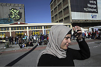 Pictured: A woman by the passenger terminal Thursday 03 March 2016<br />