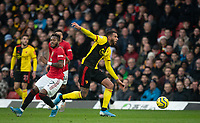 Étienne Capoue of Watford moves from Fred of Man Utd during the Premier League match between Watford and Manchester United at Vicarage Road, Watford, England on 22 December 2019. Photo by Andy Rowland.