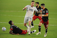 WASHINGTON, DC - AUGUST 25: Alexander Buttner #28 of New England Revolution battles for the ball with Donovan Pines #23 and Felipe Martins #18 of D.C. United during a game between New England Revolution and D.C. United at Audi Field on August 25, 2020 in Washington, DC.