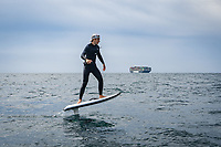 BNPS.co.uk (01202 558833)<br /> Pic: TigerCo/Fliteboard/BNPS<br /> <br /> WITH VIDEO... https://youtu.be/g3GtthQhkNI<br /> <br /> Pictured: Morgan Wylie, 19, crossing the Channel<br /> <br /> A father and son have become the first people to cross the English Channel non-stop on an eFoil board.<br /> <br /> Rob Wylie, 51, and his 19-year-old son Morgan are now world record holders after completing the 23 mile crossing in one hour and 44 minutes.<br /> <br /> They completed their mission on Fliteboards, electric-powered hydrofoil boards that hover above the water.<br /> <br /> They managed to do it on one battery charge although Rob had just four per cent battery left when they reached the shore in Folkestone, Kent.